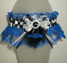 This sweet garter made with royal blue lace, black and white checkered satin band, black satin and silver shimmer bow, black feathers, royal blue race car, and a rhinestone encircled round black stone center is looking for a girl to love it!  Size: Garter stretches to 20 - for larger size, please send a message to inquire on availability.  *Garters typically arrive 2-3 business days after shipped.