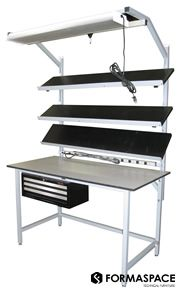 Light Industrial Workbench with angled overhead shelves. The unistruts allow for infinite height adjustment as well as the addition of new accessories.