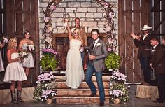 LOVE everything about this photo- 1. the deer antler arch 2. the boots 3. the country wedding 4. Blake and Miranda, of course :-)