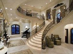 French Chateau style foyer & Y-shaped wide double staircase. by alyce