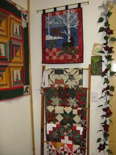 Christmas quilts on display in sewing room.