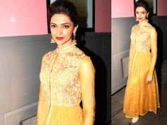 The actress looked stunning in this yellow ochre coloured full sleeve anarkali gown. The bodice of the net anarkali gown was beaded with metallic golden work. She completed the look with back swept fishtail braid and red glossy lips.