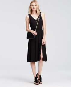 """Be dressed to the nines in this belted beauty, flaunting a body-skimming silhouette with a flowy side slit skirt. Kick it up a notch with sensational heels and sparkling statement accessories. V-neck. Sleeveless. Self tie belt. Front side slit. Lined bodice. 28"""" from natural waist."""