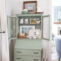St. Patrick's Day is just a couple of days away! This mint green hutch in blogger @letteredcottage's (Layla Palmer) home adds a pop of color to her white #shiplap walls. See more of her home in our Country Cottage Special Issue! #thecottagejournal #cottagestyle #cottage