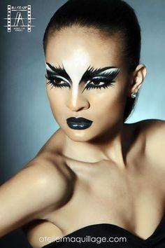 Gosto da ideia, mas faria bem mais leve, esfumado e sem photoshop. Também gosto da idéia do cisne negro ser só o batom preto.