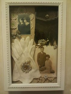 I bought this shadow box and put in my grandma's photos, gloves, jewerlies, doilies and purse.