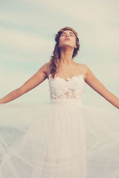 Magical white lace wedding dress with soft tulle skirt and invisible neck line.