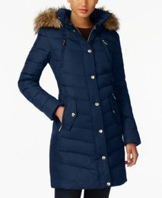 Cozy and chic in a knee-length silhouette Michael Michael Kors down-filled coat frames the face in plush faux fur.