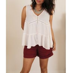 Jessica Simpson top Off white. Perfect for spring and summer! It's flowy and 100% polyester. Low V cut. Jessica Simpson Tops Blouses