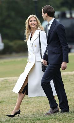 Ivanka was a vision in white wearing a double-breasted wool-garbadine coat by Jil Sander as she walked to Marine One to travel to South Carolina with her husband Jared Kushner and father President Trump.    Photo: Mark Wilson/Getty Images