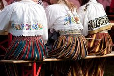 Rahvariided Estonian folk costume - - beautiful striped skirts and embroidered blouses.