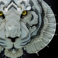 As part of an ongoing series to highlight various endangered species, Manila-based paper artist Patrick Cabral created these amazing cut paper portraits of tigers, pandas, pangolins, and other threatened animals. The multi-layered works are cut by hand and incorporate decorative flourishes and patte
