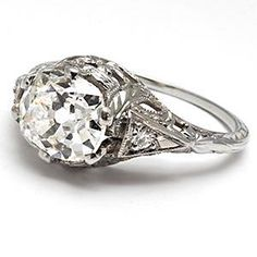This kind of looks like my vintage engagement ring. I can't find anything online that looks exactly like mine, which I guess is what makes a ring that's a family heirloom so special.