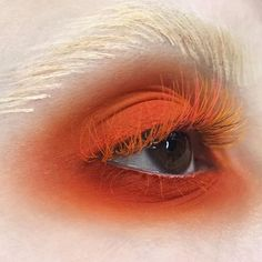 Neon orange eye make up, bleached brows