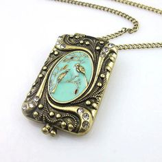 Retro style enamel embossed bird locket