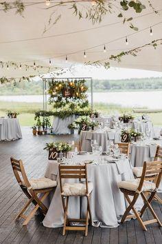 Summer rustic wedding reception under tent