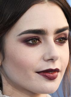 Lily's Gothic glamour. The vampy burgundy lipstick and matching eyeshadow all the way around the eyes would be borderline scary on most people, but she makes them out-of-this-world gorgeous.