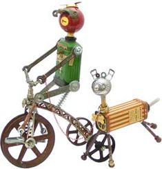 """Name: Mike the Trike                D.O.B.: 10/24/09                Height: 14""""                Principal Components: Talcum tins, pool ball, erector set pieces, wrenches, pulleys, sash lock, tea ball, toy propeller, cleat -- by Amy Flynn"""