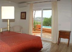 one of the bedrooms in the vila on the island of ibiza