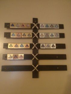 DIY Cub Scout Belt Loop Display for $1.50 using wooden rulers. Webelos Craftman #2 Requirement.