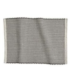 Bath Mat $12.95   Size 20 x 28 in. Details  100% cotton. Hand wash cold