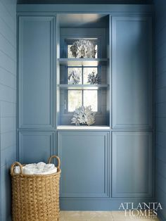 Coral has a sculptural effect in the all-blue mudroom.