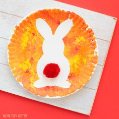 Paper plate Easter bunny craft for kids. Easy art project for toddlers, preschoolers, kindergartners and older kids to use as decoration for Easter. Easy spring rabbit craft. | at Non-Toy Gifts