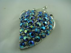 silver leaf with blue stones unsigned  visit my web at:  http://vintagecollector.ca/