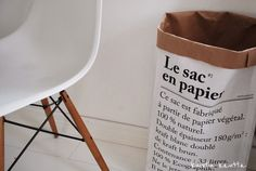 Insert a huge GLASS CYLENDER into the Le pac en papier. Then you can put plants inside, or wet umbrellas or anything wet without leakage. I saw the idea in interior design shop Cobello, but did not photograph it.  This is copied from the blog Kuistin kautta: Le sac en papier