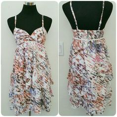 "5/$25 White abstract tiered dress Loose fitting tiered dress from Hang Ten. There are no rips or stains. Straps are adjustable. Back has ruching. Tiered skirt affect.   Measurements: Pit-pit = 12"" Pit-bottom = 24"" Hang Ten Dresses"