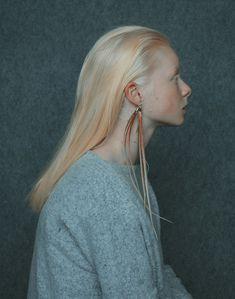 Annamária Mikulik. Earrings: nature - fake illusions, 2015. Silver, plastic. 2 x…