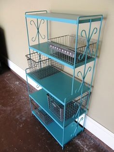 """This shelf was in my shed.  (it's metal and it was army green) Tav is using it for a TV on the top, then the metal baskets, which are from old gym lockers and one from an old fridge, are for, like it says, """"Odds n Ends"""""""