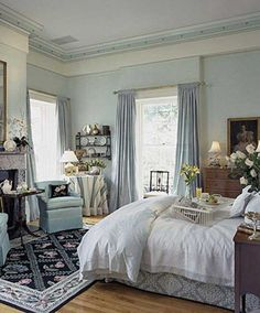 I like this type of window treatment for the bedrooms. The long curtains make the room seem larger.