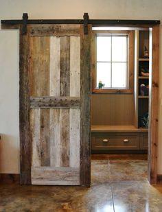 planks, rolling door    The Hennek Residence - eclectic - family room - atlanta - Resort Custom Homes