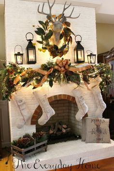 Deer head with lighted wreath Christmas mantel