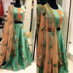 Green Designer Embroidered Wedding Lehenga.