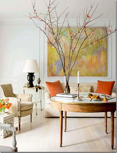In love with this table and the patina of the wood. Feels light and airy...could be the branches too!!!