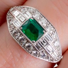 An Art Deco style platinum, emerald and diamond plaque ring. View our collection at www.rutherford.com