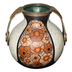 Art Deco Pottery Amphora Vase by Louis Dage | From a unique collection of antique and modern vases and vessels at https://www.1stdibs.com/furniture/decorative-objects/vases-vessels/