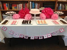 DIY sweets table. Made these cake stands, banner, and tissue puffs from scratch