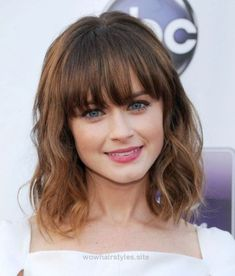 Medium Length Wavy Hairstyles With Bangs