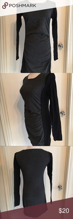 Express Ruched Side Sweater Dress Color Blocked Unique Sweater dress from Express in color blocked grey and black. Ruching down the sides is super comfy and flattering. Crew/slight scoop neck. Long sleeve. Really soft and stretchy. Fits true to size. This is perfect work, date night or a weekend day - super versatile. In very good condition. Some general wear, but not holes or stains. Express Dresses Long Sleeve