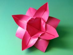 Origami: Fiore ad otto petali - Flower with eight petals, by Francesco Guarnieri, link to the diagrams.