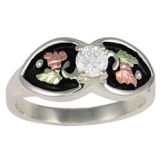 Metal: Sterling Silver12K Rose and Green leavesAntique accent4mm round white cubic zirconiaColeman Black Hills Gold Jewelry is nickel free.Rings can be ordered in half sizes at no extra chargeMade in USA