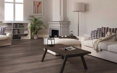 Los suelos con tarimas oscuras combinados con carpintería blanca, dar un aire muy actual y moderno a su hogar