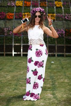 Flower power is never stronger than at Coachella! We love the boho-feminine look achieved by a bud-print maxi, a lacy white top, and a bold floral wreath.