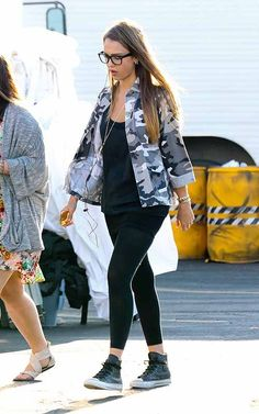 Black Leggings, Black Sweater, Camo Jacket, Hi Top Sneakers and Geek Glasses. Jessica Alba Street Style!