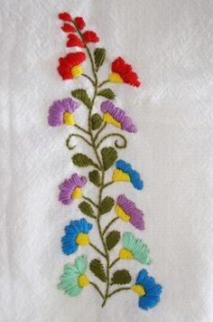 """Here's the completed piece, based on the free embroidery pattern above.  If you look carefully, you can see where the """"stem"""" and """"back"""" stitches have been used to create a textured, three-dimensional effect."""