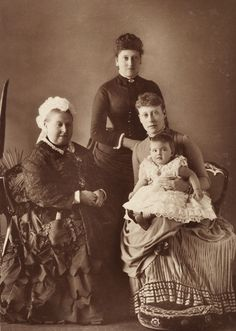 Queen Victoria with her youngest daughter, Princess Beatrice, and her grand-daughter Princess Victoria of Hesse and by Rhine (The daughter of Princess Alice). In Victoria's lap is her eldest daughter, Princess Alice of Battenberg, who would be the mother of Prince Philip, Duke of Edinburgh.