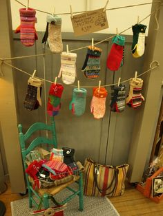 Clothesline to hang mittens with clothespins. You could do this on top of a craft fair table if you built a simple structure with two poles and a base.